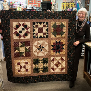 Margie with Margie's Magnificent Beginner's Quilt Sample